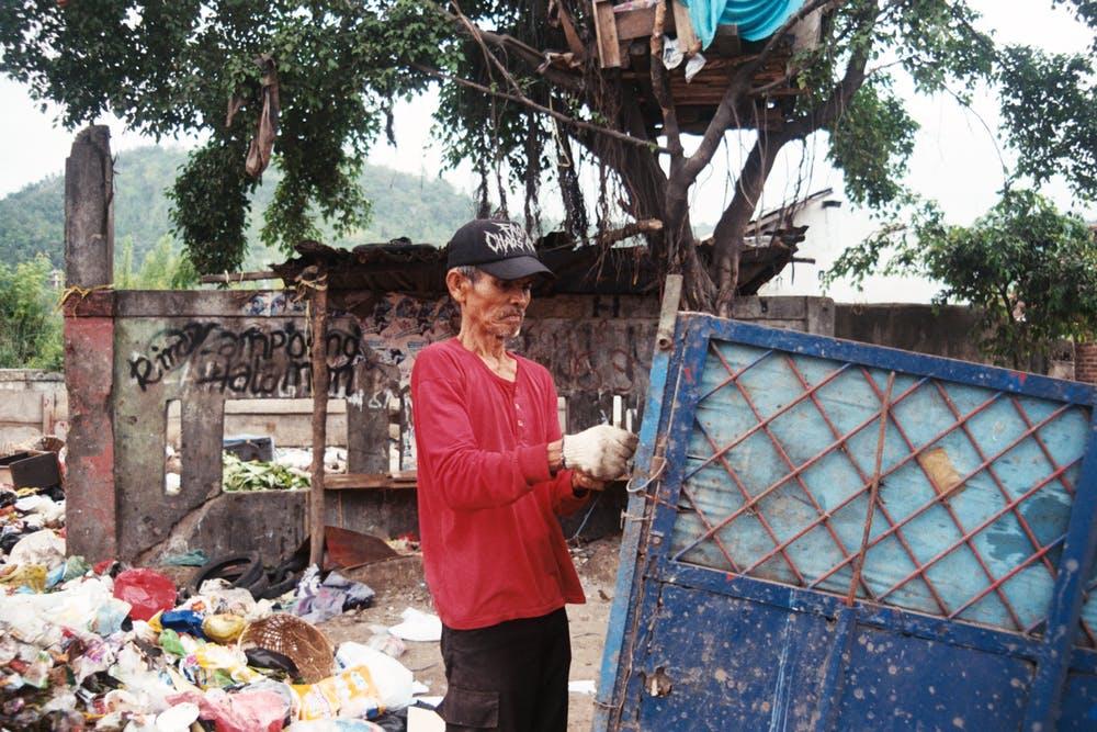 man handling wastes