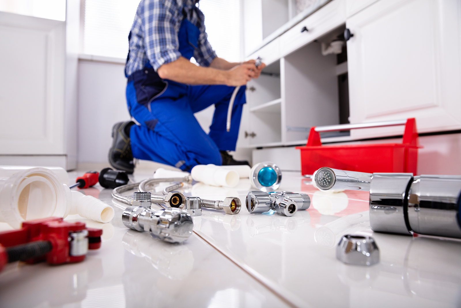 Emergency plumber in Sydney and his tools on the floor