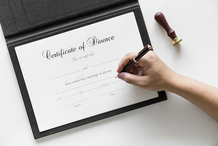 certificate of divorce being signed