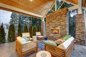 Chic patio with teak outdoor furniture