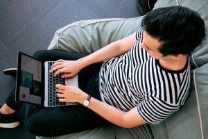 Young man undertaking online internships
