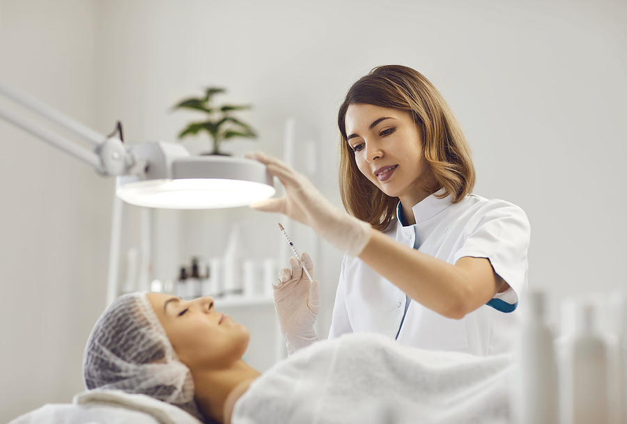 Beautician in Sydney CBD doing a facial to a client