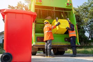 Two men working in a rubbish removal in Inner West