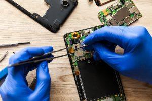 Technician servicing same day phone repair